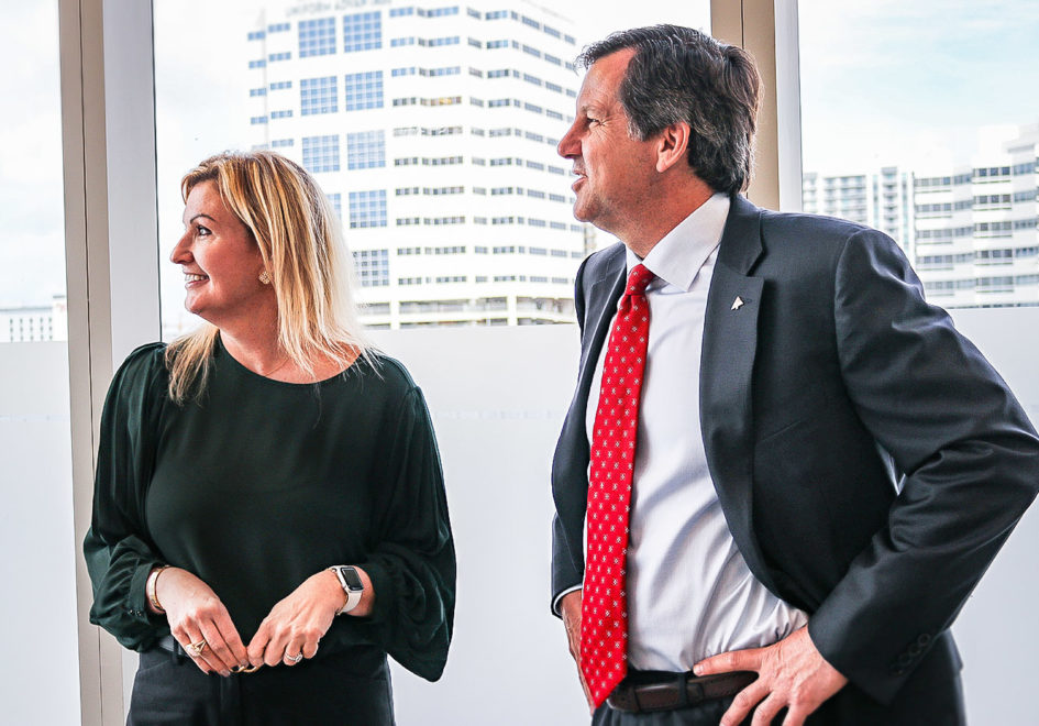 Fort Lauderdale and West Palm Beach Market Executive Kelley Brown-Murro, left, and Florida Commercial Banking Executive Tony Stiffler take a moment to view the skyline from Region's office in Fort Lauderdale.