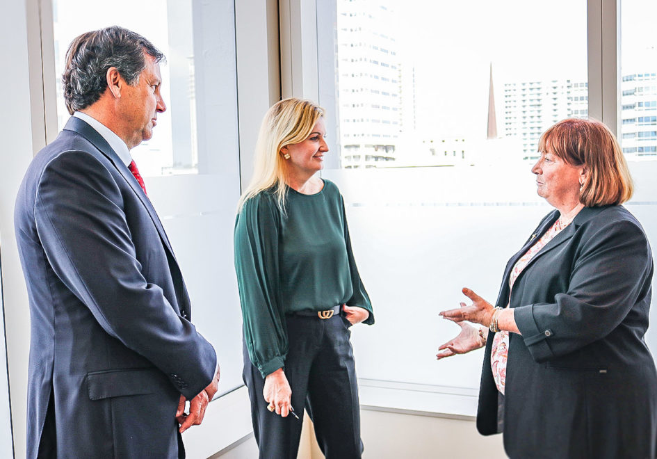 Senior Field Investigator with Regions Corporate Security Beth Purdie, right, Fort Lauderdale and West Palm Beach Market Executive Kelley Brown-Murro, center, and Florida Commercial Banking Executive Tony Stiffler speak after the conclusion of the fraud-prevention forum.