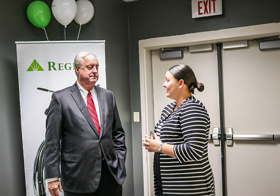 Regions' Atlanta-area Market Executive, Bill Linginfelter, left, speaks with Georgia State University Senior Woman Administrator Kelcey Roegiers, right, about the bank's community engagement priorities that support economic and community development, education and workforce readiness and financial wellness.