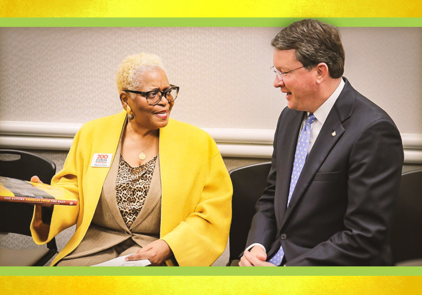 Patricia Ford, left, Director of the State Black Archives Research Center & Museum, is part of the Alabama Bicentennial Commission. Here, she speaks with Robert Birmingham, right, Executive Vice President from Regions in Montgomery, about the new book.