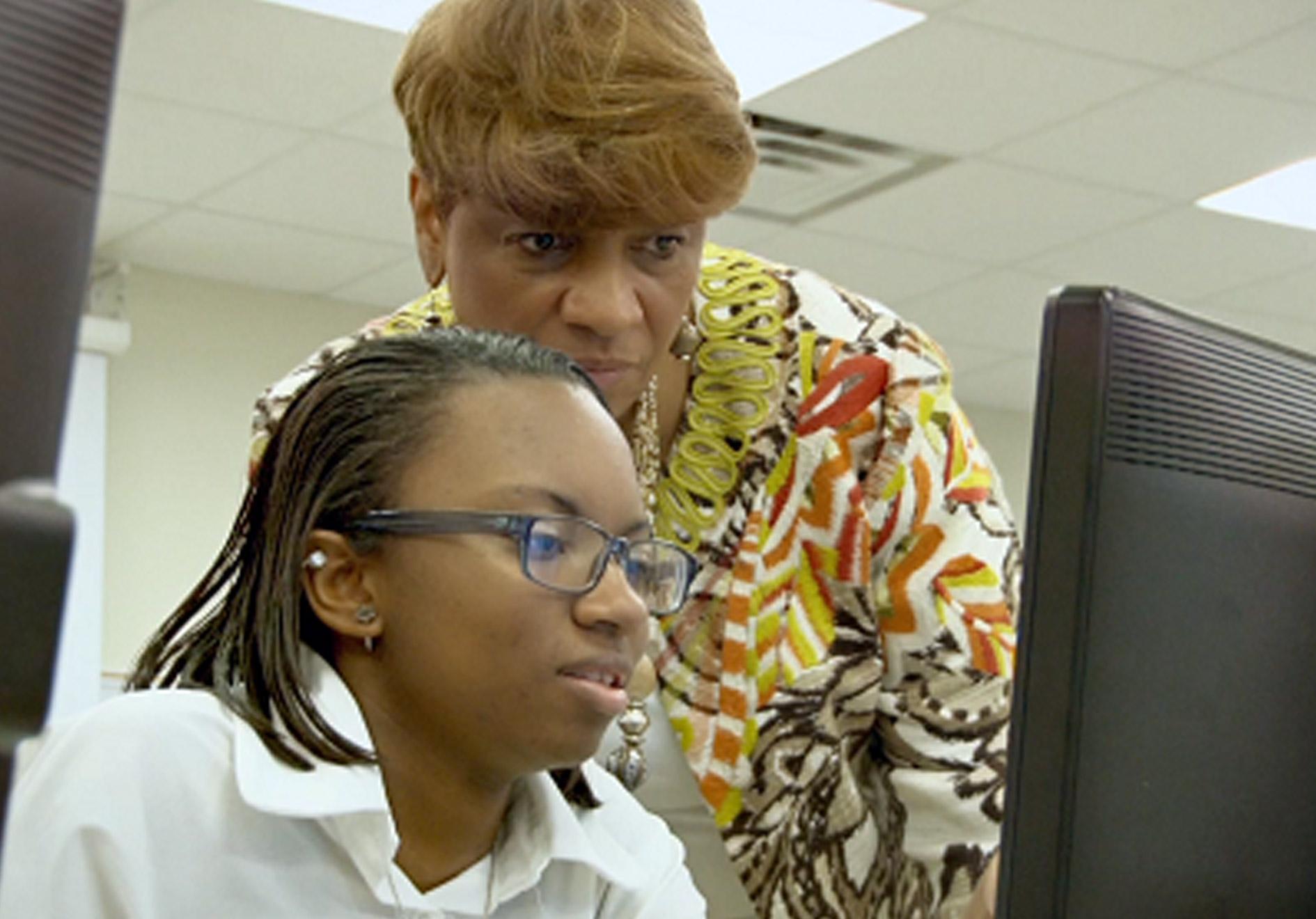 Janice Stewart Helps Student